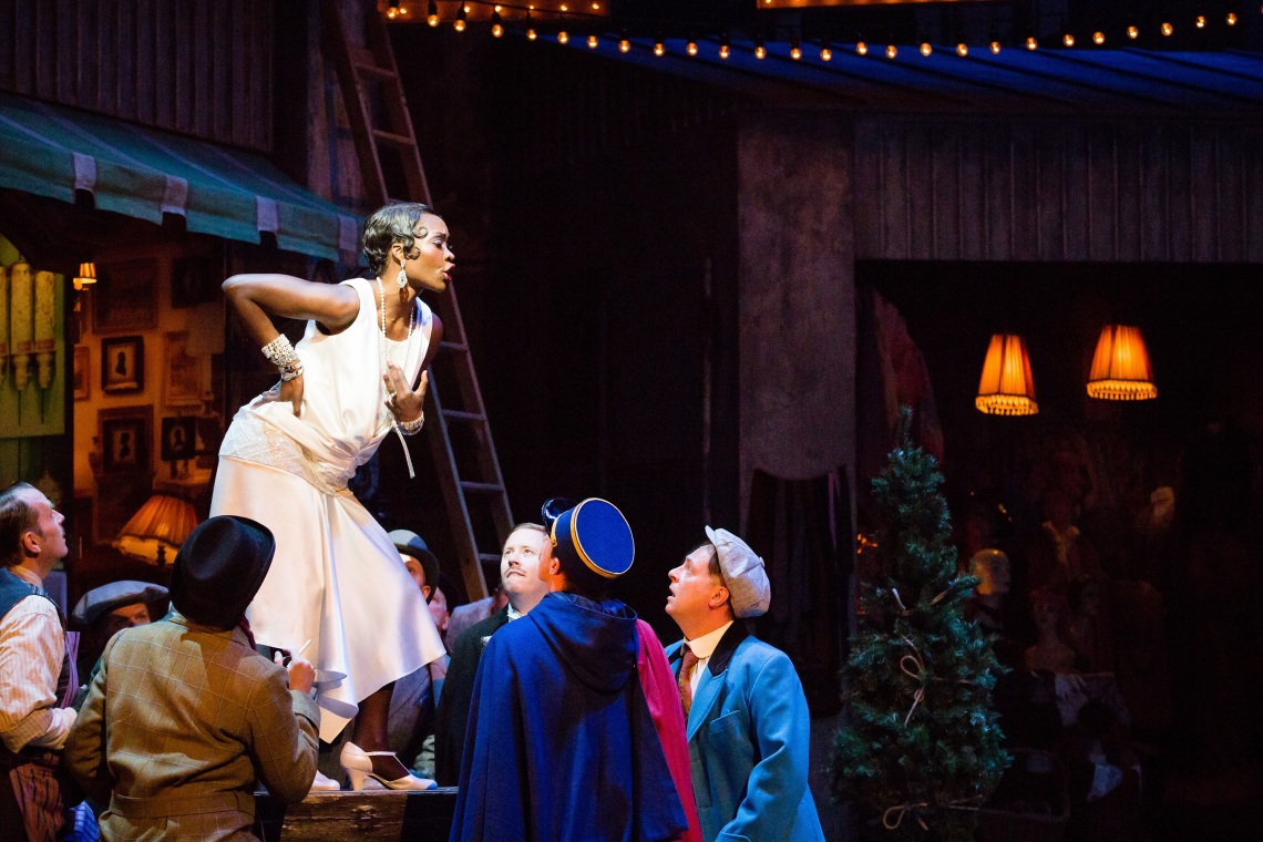 Jeanine De Bique (Musetta) and the chorus of La bohème. Scottish Opera 2017. Credit Sally Jubb.jpg